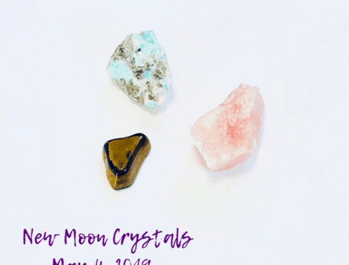 three crystals laying on a white table - Tiger's Eye, Rose Quartz, and Amazonite